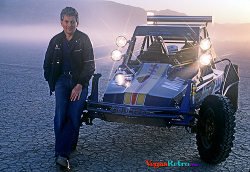 KJ Howe on the dry lake at state line with Mint 400 car