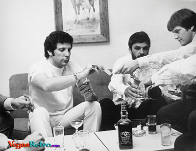 Photo of Tom Jones in his dressing room backstage in Las Vegas in 1967 playing poker