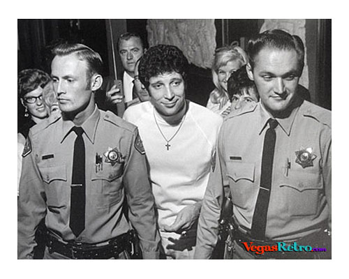 Photo of Tom Jones with fans and cops backstage in Las Vegas circa 1967