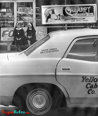 Photo of Nuns and a sexy stripper cab sign