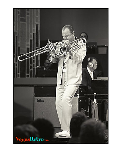 Photo of Bob Mitchell playing two trumpets on the Sammy Davis Jr show