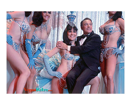Photo of actor Gene Kelly with Tropicana Showgirls