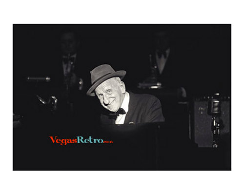 Photo of Jimmy Durante playing piano on Las Vegas stage in 1968