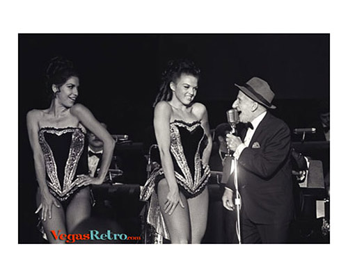 Photo of Jimmy Durante and showgirls on the Las Vegas stage