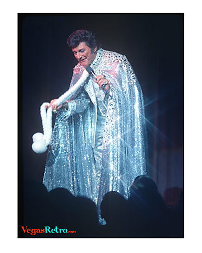 Liberace communes with his audience on Vegas stage