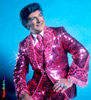 Portrait of Liberace in pink suit