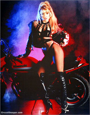 "Photo of Melinda, ""First Lady of Magic"" and motorcycle"