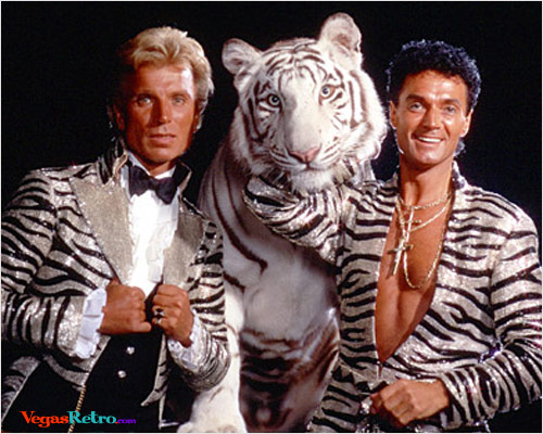 Photo of Siegfried & Roy with white tiger