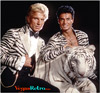 Image of Siegfried & Roy with white tiger