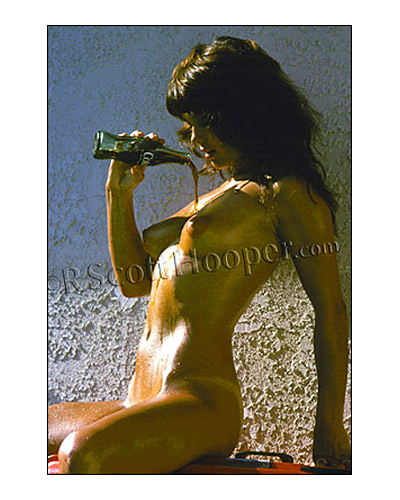 Photo of nude pouring Coca-cola on her naked body