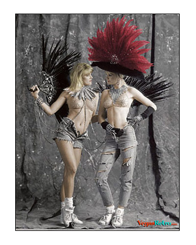 "photo of two ""Folies Bergere"" showgirls in costume with tennis shoes"
