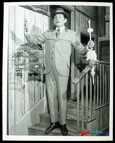 Photo of Gene Barry on stage