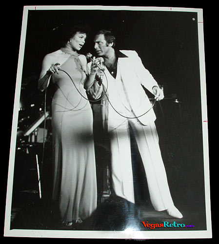 Photo of Paul Anka & Odia Coates on a Las Vegas stage