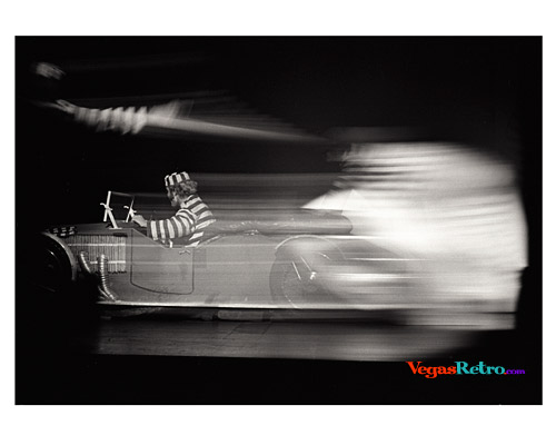 Image of a speeding car on stage in the Casino de Paris show