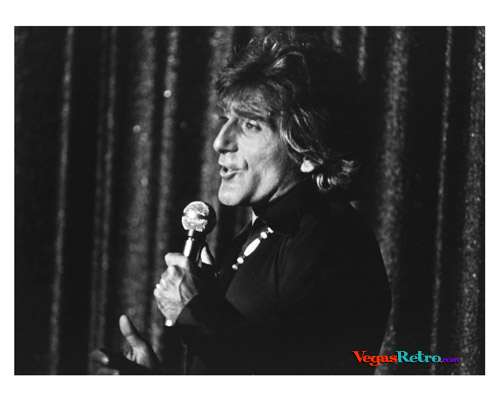 "Photo of male singer on stage in ""Vive Paris Vive"" Show in Las 1975 Vegas"