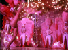 Image of Las Vegas Showgirls in pink feathers and a high kicking dancer